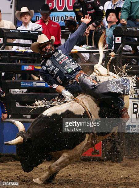 Ednei Caminhas attempts to ride a bull during Round 2 of the PBR Amp'd Mobile Invitational in the 2007 Professional Bull Riders Built Ford Tough...