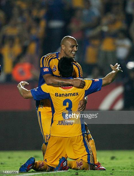 Edno Cunha and Juninho of Tigres celebrate against Chivas during a match between Chivas v Tigres as part of Clausura 2012 at Universitario Stadium on...