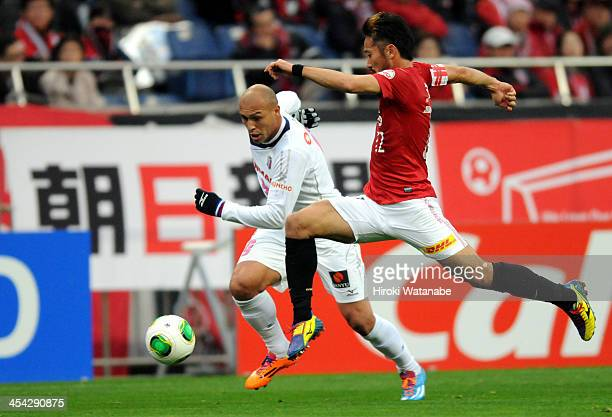 Edno Roberto Cunha of Cerezo Osaka and Yuki Abe of Urawa Red Diamonds compete for the ball during the JLeague match between Urawa Red Diamonds and...