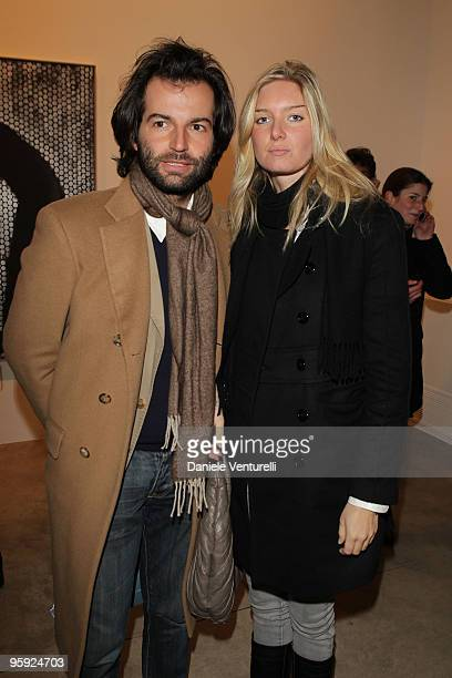 Edoardo Francia and Guest attend the Jorg Immendorff show at the Cardi Black Box Gallery on January 21 2010 in Milan Italy
