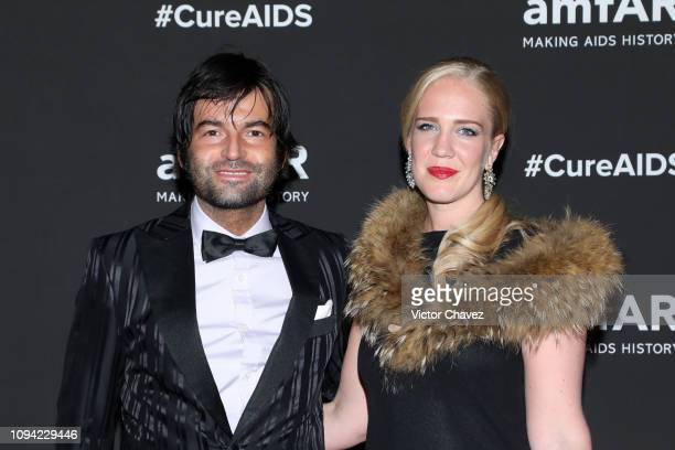 Edoardo Francia and Johanna Bertilsson pose during the amfAR gala dinner at the house of collector and museum patron Eugenio López on February 5 2019...