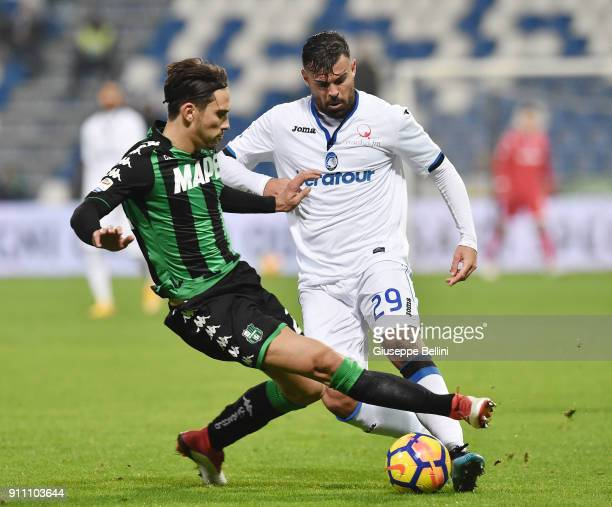 Edoardo Goldaniga of US Sassuolo and Andrea Petagna of Atalanta BC in action during the serie A match between US Sassuolo and Atalanta BC at Mapei...