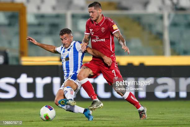 Edoardo Masciangelo of Pescara Calcio compete for the ball with Pasquale Mazzocchi of AC Perugiaduring the serie B Play-Out first leg match between...