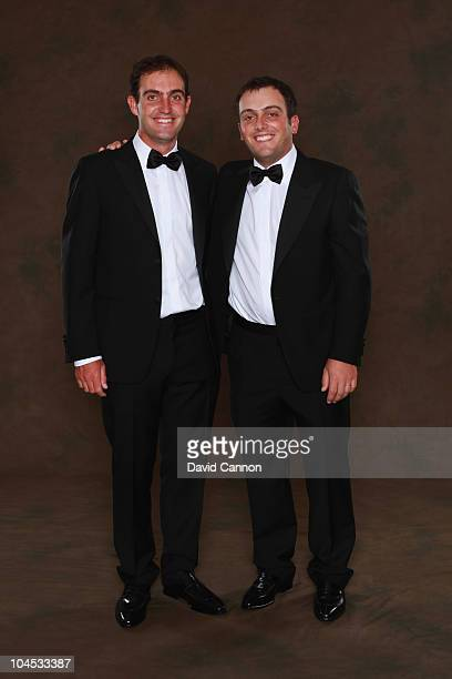 Edoardo Molinari and Francesco Molinari of the European Ryder Cup team pose prior to the 2010 Ryder Cup Dinner at the Celtic Manor Resort on...