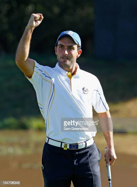 Edoardo Molinari of Europe celebrates holing a putt on the 3rd green in the singles matches during the 2010 Ryder Cup at the Celtic Manor Resort on...