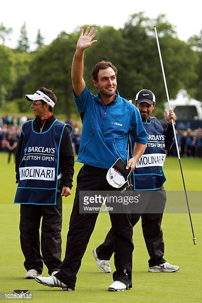 Edoardo Molinari of Italy acknowledges the crowd on the 18th green after winning The Barclays Scottish Open at Loch Lomond Golf Club on July 11 2010...