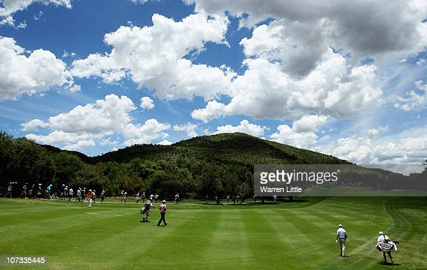 Edoardo Molinari of Italy and Padraig Harrington of Ireland make their way up the third fairway during the final round of the 2010 Nedbank Golf...