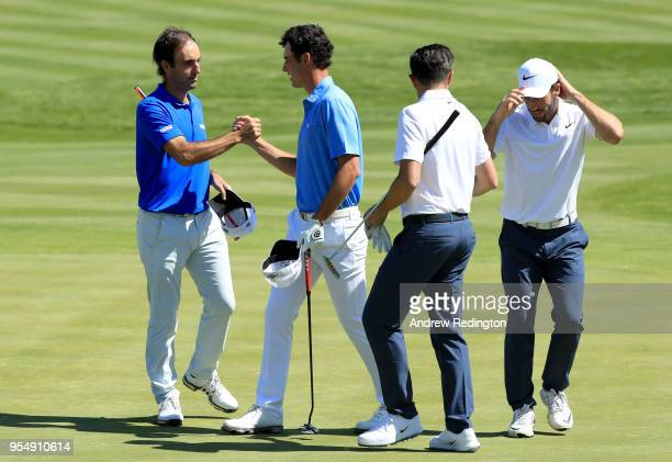 Edoardo Molinari of Italy and Renato Paratore of Italy celebrate victory as Michael LorenzoVera of France and Romain Wattel of France react during...