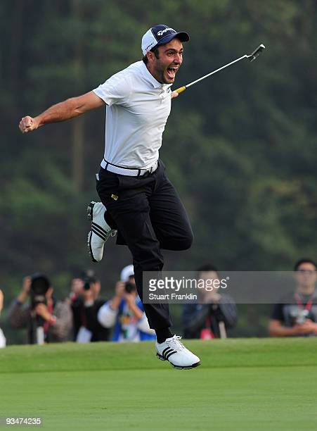 Edoardo Molinari of Italy celebrates holeing the winning putt on the 18th green during Foursomes on the final day of the Omega Mission Hills World...