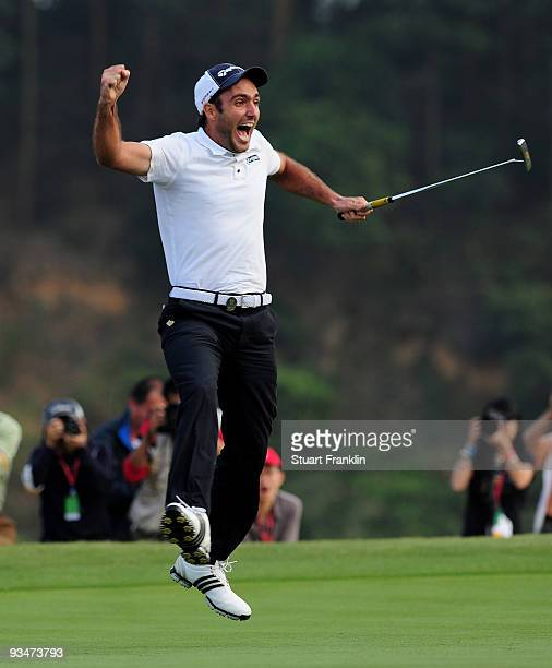 Edoardo Molinari of Italy celebrates holing the winning putt on the 18th green during Foursomes on the final day of the Omega Mission Hills World Cup...