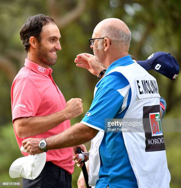 Edoardo Molinari of Italy celebrates with his caddie Andy Forsyth following victory during the fourth round of the Trophee Hassan II at Royal Golf...