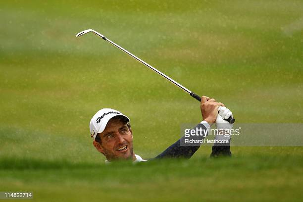 Edoardo Molinari of Italy hits from a bunker on the 3rd hole during the second round of the BMW PGA Championship at the Wentworth Club on May 27,...