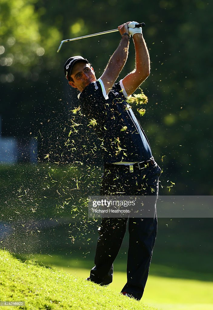 Edoardo Molinari of Italy hits his 2nd shot on the 16th hole during day 1 of the BMW PGA Championship at Wentworth on May 21, 2015 in Virginia Water, England.