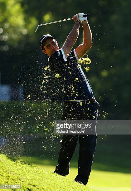 Edoardo Molinari of Italy hits his 2nd shot on the 16th hole during day 1 of the BMW PGA Championship at Wentworth on May 21 2015 in Virginia Water...
