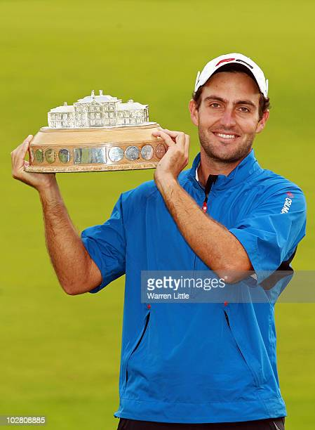 Edoardo Molinari of Italy holds the trophy after winning The Barclays Scottish Open at Loch Lomond Golf Club on July 11 2010 in Luss Scotland