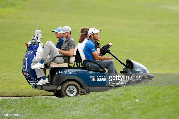 Edoardo Molinari of Italy leaves the course as play is suspended due to weather during the third round on day four of Andalucia Valderrama Masters at...