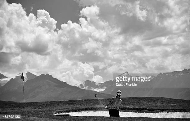 Edoardo Molinari of Italy plays a shot during the second round of the Omega European Masters at CranssurSierre Golf Club on July 24 2015 in...