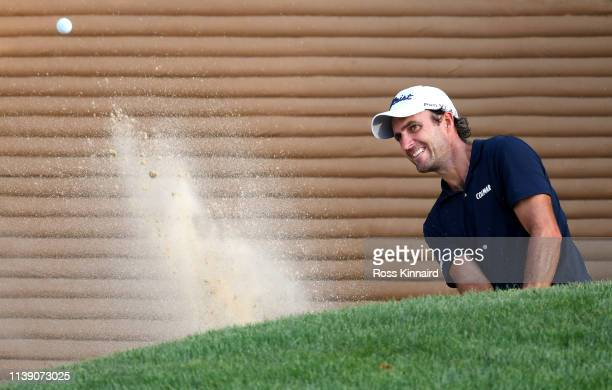 Edoardo Molinari of Italy plays a shot out of the bunker during round two of the Hero Indian Open at the DLF Golf & Country Club on March 29, 2019 in...