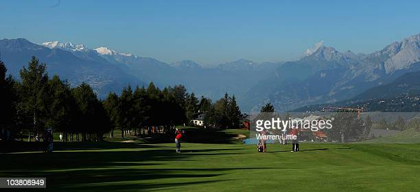 Edoardo Molinari of Italy plays his second shot into the 14th green during the second round of The Omega European Masters at CransSurSierre Golf Club...
