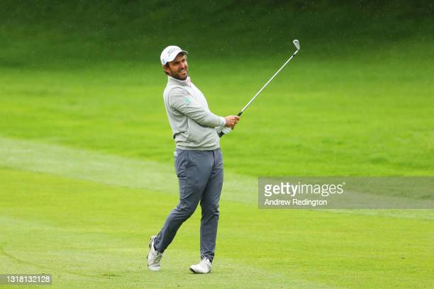 Edoardo Molinari of Italy plays his second shot on the first hole during the Final Round of The Betfred British Masters hosted by Danny Willett at...