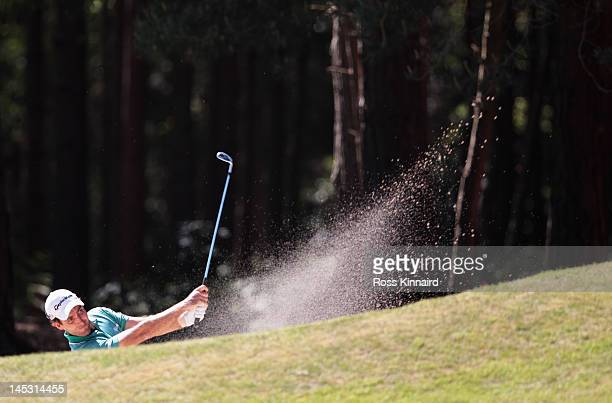 Edoardo Molinari of Italy plays out of a bunker on the 13th hole during the third round of the BMW PGA Championship on the West Course at Wentworth...