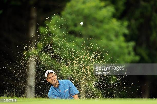 Edoardo Molinari of Italy plays out of a bunker on the fourth hole during round Four of The Barclays Scottish Open at Loch Lomond Golf Club on July...