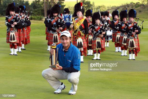 Edoardo Molinari of Italy poses with the trophy after winning The Johnnie Walker Championship at Gleneagles at the Gleneagles Hotel and Resort on...