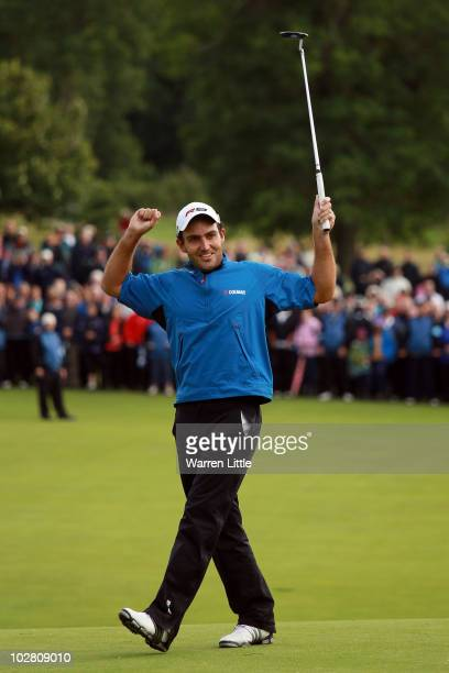 Edoardo Molinari of Italy reacts to a missed birdie putt on the 18th green during round four of The Barclays Scottish Open at Loch Lomond Golf Club...