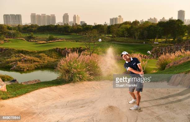 Edoardo Molinari of Itlay plays a shot from the greenside bunker on the 17th hole during practice prior to the start of the Hero Indian Open at Dlf...