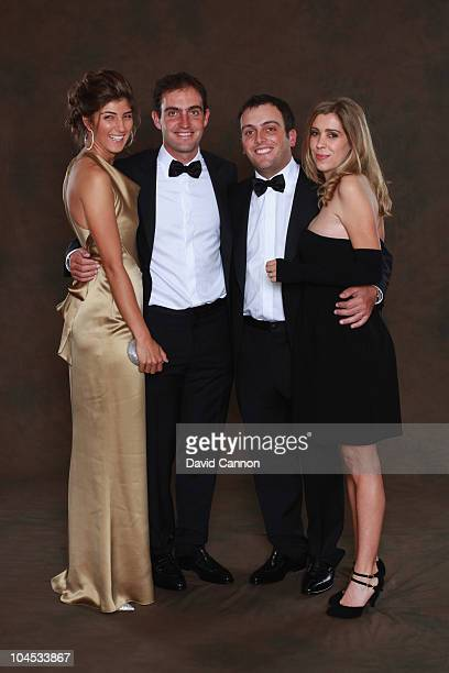 Edoardo Molinari of the European Ryder Cup team poses with his partner Anna Roscio alongside his brother Francesco Molinari and his wife Valentina...