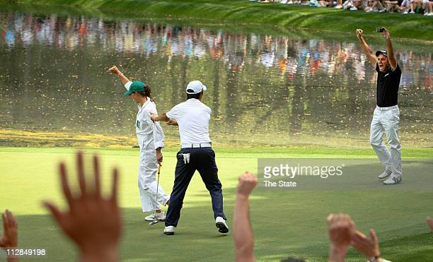 Edoardo Molinari right and his brother Francesco left of Italy cheer for Edoardo's girlfriend Anna Roscio after her birdie putt on the ninth green...