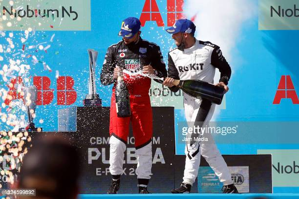 Edoardo Mortara of Italy from Rokit the Venturi Racing team celebrates with Pascal Wehrlein of Germany from the Tag Heuer Porsche FE team after their...