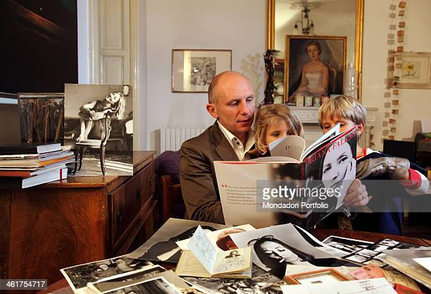 Edoardo Perazzi writer and journalist Oriana Fallaci's nephew and sole heir photographed at home with his children Nina and Ludovico Milan Italy 17th...