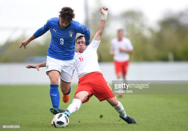 Edoardo Vergani of Italy battles for posession with Drilon Kastrati of Switzerland during the UEFA European Under17 Championship Group A match...