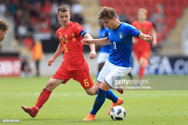 Edoardo Vergani of Italy battles with Nicolas Raskin of Belgium during the UEFA European Under17 Championship Semi Final match between Italy and...