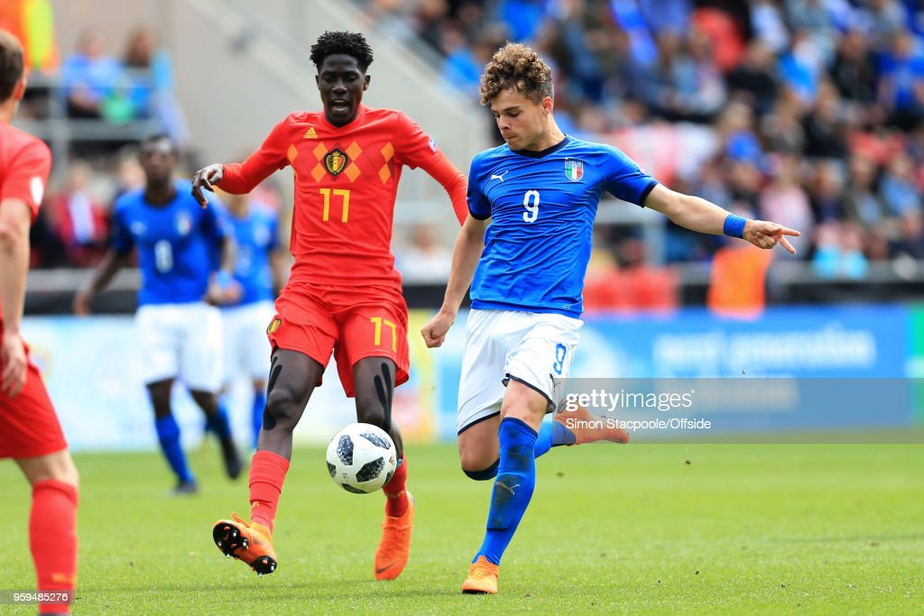 Edoardo Vergani of Italy scores their 2nd goal past Amadou Onana of Belgium during the UEFA European Under-17 Championship Semi Final match between Italy and Belgium at the Aesseal New York Stadium on May 17, 2018 in Rotherham, England.