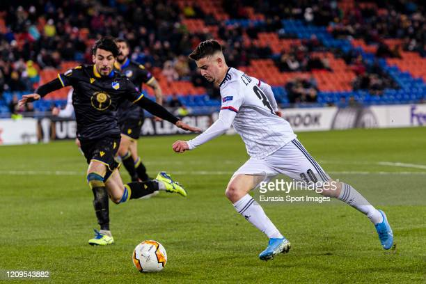 Edon Zhegrova of Basel looks to bring the ball down during the UEFA Europa League round of 32 second leg match between FC Basel and APOEL Nikosia at...