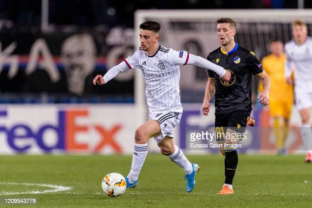 Edon Zhegrova of Basel plays against Dragan Mihajlovic of Apoel during the UEFA Europa League round of 32 second leg match between FC Basel and APOEL...