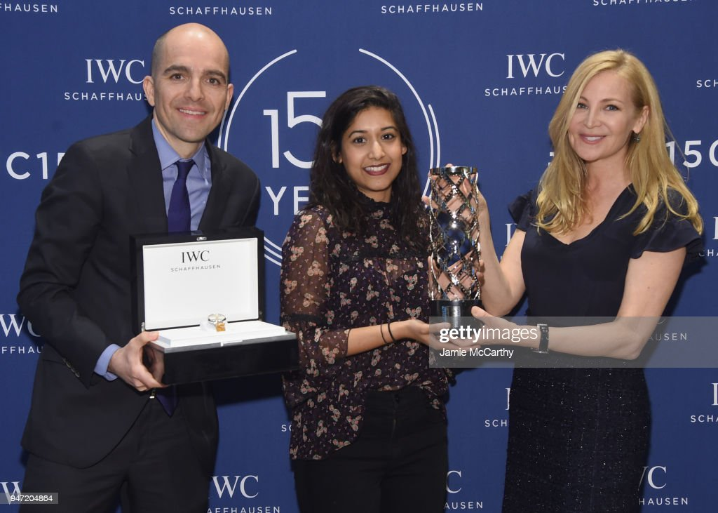 Edouard dArbaumont (L) and Jennifer Westfeldt (R) present Sonejuhi Sinha (C) with the IWC Filmmaker Award at the IWC Tribeca Film Festival Filmmaker Award Celebration on April 16, 2018 in New York City.