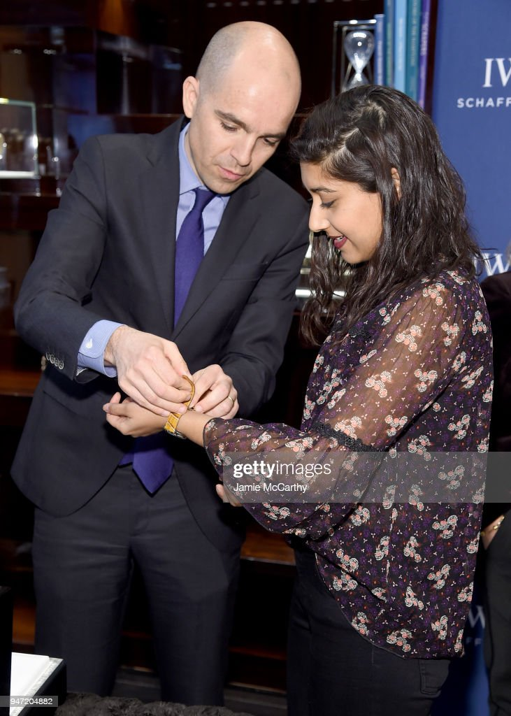 Edouard dArbaumont presents Sonejuhi Sinha with her new IWC Portofino watch at the IWC Tribeca Film Festival Filmmaker Award Celebration on April 16, 2018 in New York City.