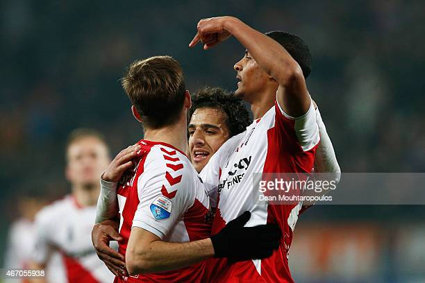 Edouard Duplan of Utrecht is congratulated by team mates after he scores his teams first goal during the Dutch Eredivisie match between FC Utrecht...