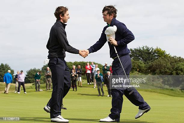 Edouard Espana of the Continent of Europe team is congratulated by Alan Dunbar of the Great Britain and Ireland team following victory in the morning...
