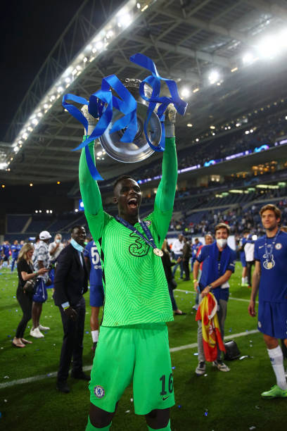 Edouard Mendy of Chelsea celebrates with the Champions League Trophy following their team's victory in the UEFA Champions League Final between...