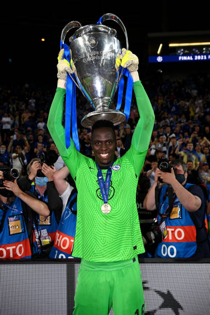 Edouard Mendy of Chelsea celebrates with the Champions League Trophy during the UEFA Champions League Final between Manchester City and Chelsea FC at...
