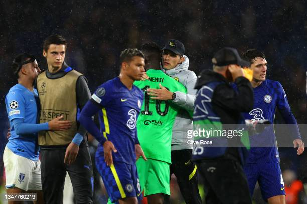 Edouard Mendy of Chelsea embraces Thomas Tuchel, Manager of Chelsea at full-time after the UEFA Champions League group H match between Chelsea FC and...