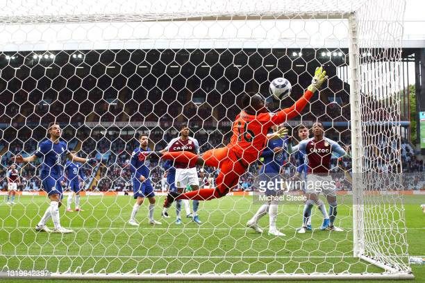 Edouard Mendy of Chelsea fails to save from Bertrand Traore of Aston Villa as he scores his side's first goal during the Premier League match between...