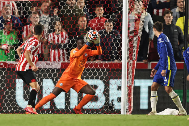 Edouard Mendy of Chelsea makes a close range save during the Premier League match between Brentford and Chelsea at Brentford Community Stadium on...