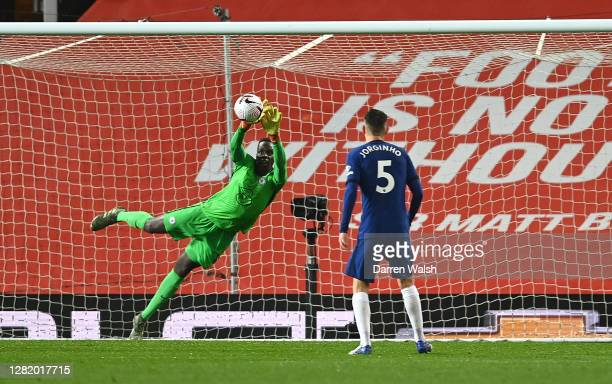 Edouard Mendy of Chelsea makes a save during the Premier League match between Manchester United and Chelsea at Old Trafford on October 24, 2020 in...