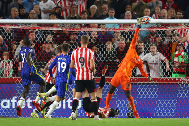 Edouard Mendy of Chelsea makes a save during the Premier League match between Brentford and Chelsea at Brentford Community Stadium on October 16,...