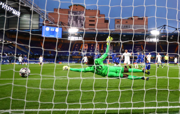 Edouard Mendy of Chelsea makes a save during the UEFA Champions League Semi Final Second Leg match between Chelsea and Real Madrid at Stamford Bridge...